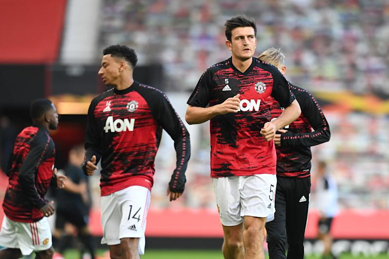 MANCHESTER, ENGLAND - AUGUST 05: Jesse Lingard and Harry Maguire of Manchester United warm up prior to during the UEFA Europa League round of 16 second leg match between Manchester United and LASK at Old Trafford on August 05, 2020 in Manchester, England. (Photo by Michael Regan/Getty Images)