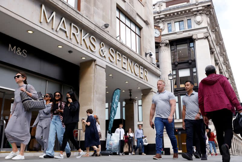 FILE PHOTO: People walk outside the Marks&Spencer shop amid the outbreak of the coronavirus disease (COVID-19), in Oxford Street