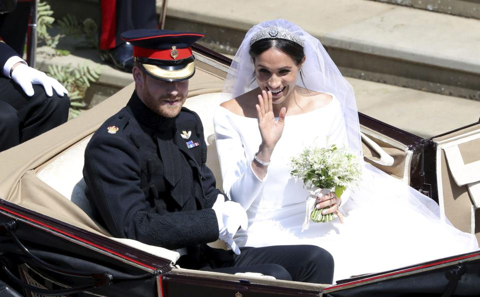 Prince Harry and Meghan Markle leave after their wedding at St. George's Chapel.