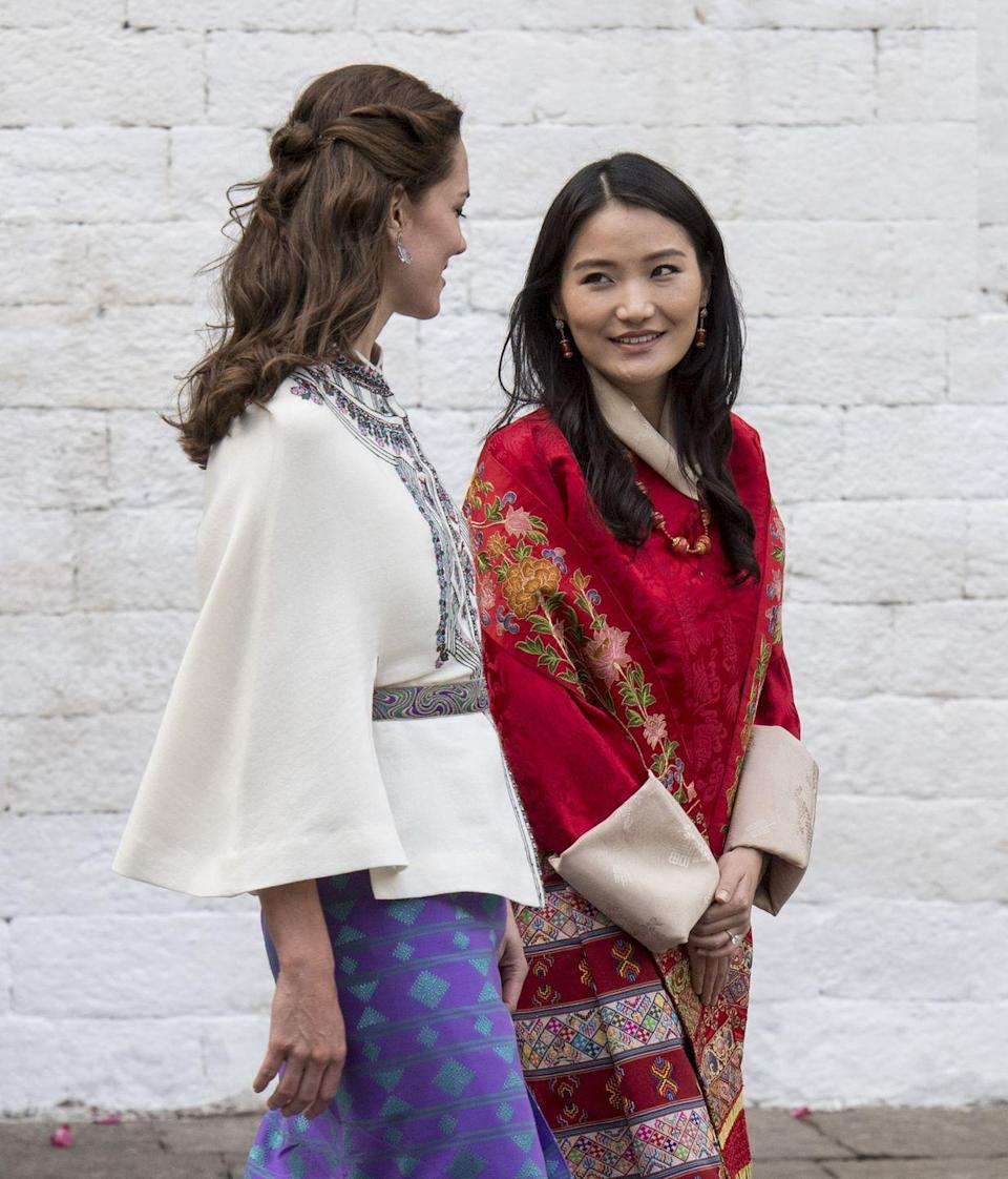 "<p>Dubbed the ""Kate Middleton of the Himalayas,"" Queen Jetsun Pema of Bhutan is currently the youngest Queen in the world at age 27. In May 2011, Jetsun became the ""Dragon Queen of Bhutan"" when she married ""Dragon King"" Jigme Khesar Namgyel Wangchuck, who is 10 years her senior. (Yes, their lavish wedding took place one month after Kate Middleton and Prince William's.) Here's Queen Jetsun Pema showing Catherine, the Duchess of Cambridge, around during Kate and Will's <a href=""http://www.cosmopolitan.com/entertainment/celebs/news/a56852/kate-middleton-archery-katniss-bhutan-dress/"" rel=""nofollow noopener"" target=""_blank"" data-ylk=""slk:royal visit to India and Bhutan in April 2016"" class=""link rapid-noclick-resp"">royal visit to India and Bhutan in April 2016</a>.</p>"