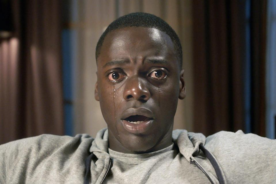 """<p>Jordan Peele cast Kaluuya in his biggest film role yet as Chris Washington in the 2017 horror-thriller <em>Get Out</em>, earning the star well-deserved recognition including an Oscar nomination for Best Performance by an Actor in a Leading Role and a Screen Actors Guild Award nomination for outstanding performance by a cast in a motion picture. The film went on to make more than $200 million at the worldwide box offices, according to <em><a href=""""https://deadline.com/2017/05/get-out-crosses-200-million-worldwide-box-office-1202086034/"""" rel=""""nofollow noopener"""" target=""""_blank"""" data-ylk=""""slk:Deadline"""" class=""""link rapid-noclick-resp"""">Deadline</a></em>, and made Kaluuya a household name in the U.S.</p>"""