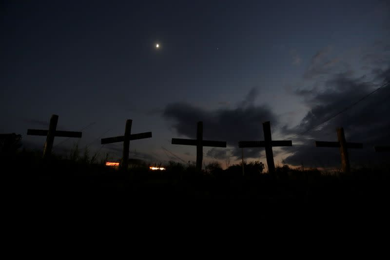 Crosses that represent 65 miners who died during an explosion in 2006 in Pasta de Conchos coal mine, are seen along a highway in San Juan de Sabinas
