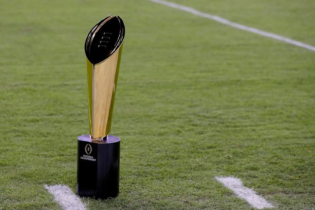 Who will vie for the College Football Playoff National Championship trophy? It's down to four teams. (Getty)