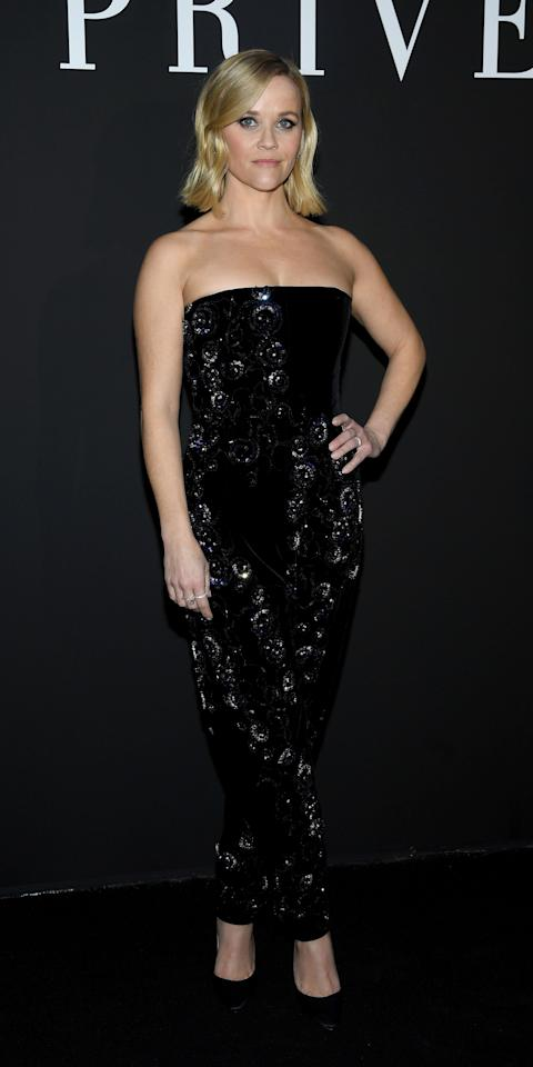 <p>Forget fancy dresses — Reese has convinced has convinced us to wear a jumpsuit to our next big event. The star popped up at the Giorgio Armani Privé Haute Couture Spring 2020 show in Paris while rocking this embellished, velvet number, and suddenly, we couldn't focus on anything else.</p>