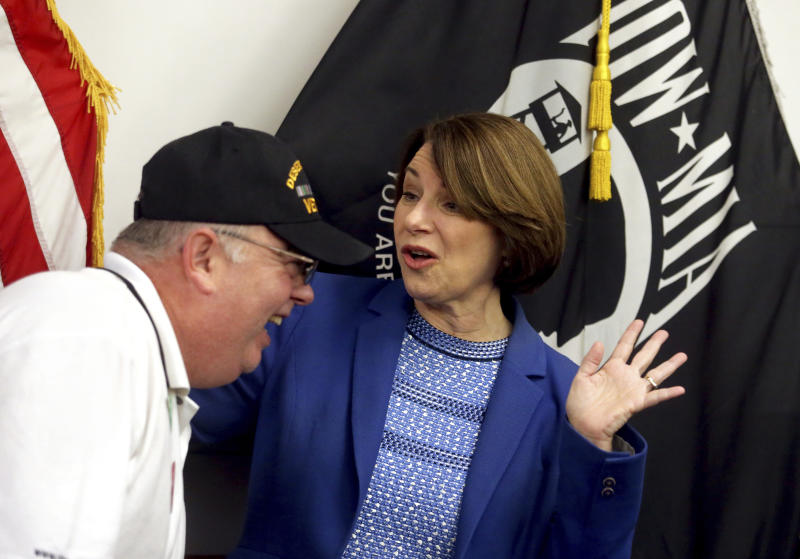 Presidential candidate U.S. Sen. Amy Klobuchar, D-MN., speaks to Joe Stutler, of Marion, Iowa, after her roundtable with veterans at Carnegie-Stout Public Library in Dubuque on Saturday, Oct. 19, 2019.(Eileen Meslar/Telegraph Herald via AP)