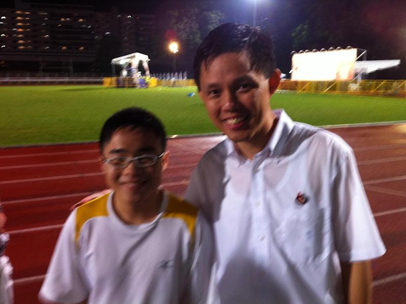 The author with Mr Chan Chun Sing, who was a new PAP candidate, at a rally at Woodlands Stadium during the GE 2011 hustings. (PHOTO: Sean Lim)