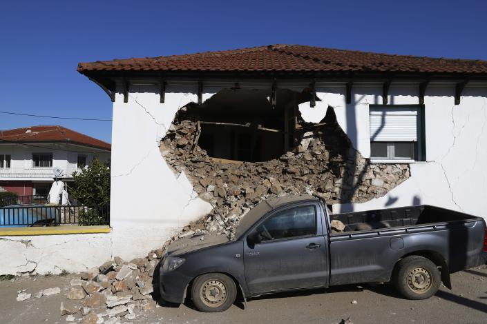 Damage is seen on a house after an earthquake in Damasi village, central Greece, Wednesday, March 3, 2021. An earthquake with a preliminary magnitude of up to 6.3 struck central Greece on Wednesday and was felt as far away as the capitals of neighboring Albania, North Macedonia, Kosovo and Montenegro. (AP Photo/Vaggelis Kousioras)