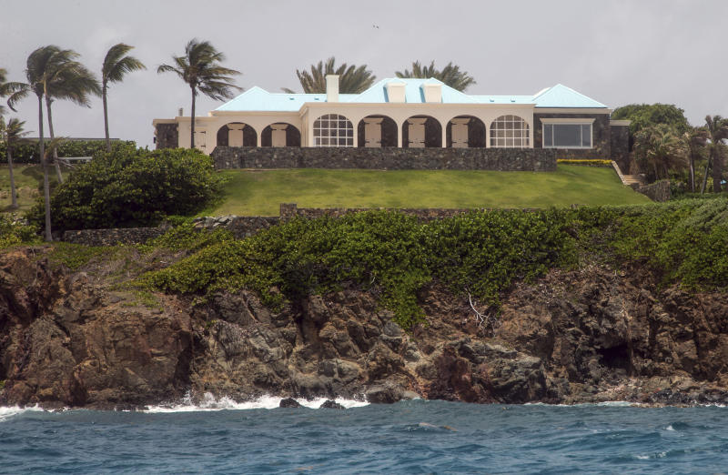 This Tuesday, July 9, 2019 photo shows a structure on Little Saint James Island, in the U. S. Virgin Islands. Locals recalled seeing Jeffery Epstein's black helicopter flying back and forth from the international airport in St. Thomas to his helipad on Little St. James Island, where he built a cream colored mansion with a bright turquoise roof surrounded by several other structures including the maids' quarters and a massive, square-shaped white building on one end of the island that some say is a music room fitted with acoustic walls. (AP Photo/Gianfranco Gaglione)