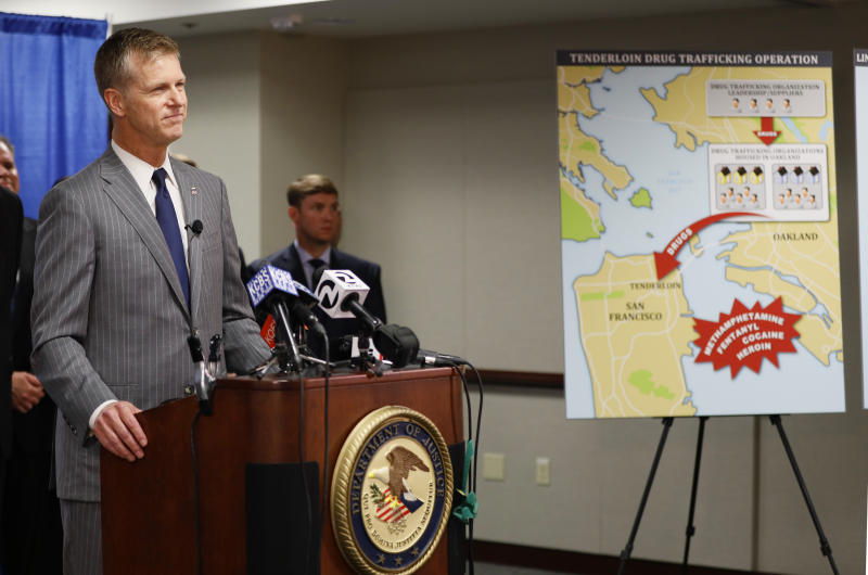 U.S. Attorney David Anderson announces a new federal crime-fighting initiative in San Francisco on Wednesday, Aug. 7, 2019. Seventeen federal law enforcement agencies will team up for a yearlong crackdown on a notorious area of San Francisco where open drug use has been tolerated for years. (AP Photo/Samantha Maldonado)