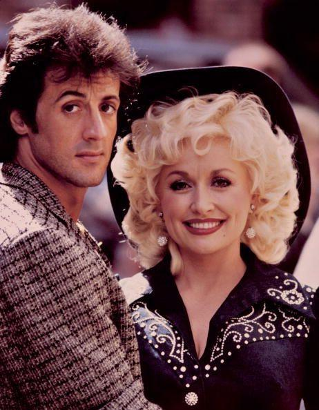 <p>Parton goes country chic while starring in <em>Rhinestone</em> with Sylvester Stallone.</p>