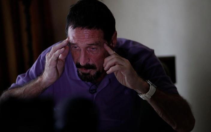 McAfee gestures as he speaks during an interview with Reuters in Guatemala City in 2012 - Reuters