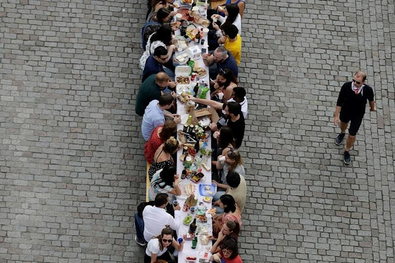 At 500-metre table, Prague Citizens See Coronavirus Out with a Dinner on the Medieval Charles Bridge