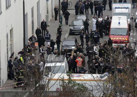 FILE PHOTO: General view of police and rescue vehicles at the scene after a shooting at the Paris offices of Charlie Hebdo, a satirical newspaper, January 7, 2015.  REUTERS/Philippe Wojazer