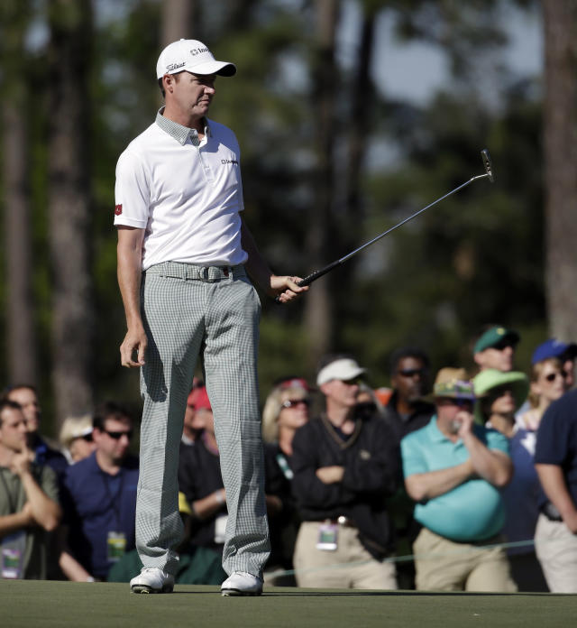 Jimmy Walker watches his putt on the first green during the first round of the Masters golf tournament Thursday, April 10, 2014, in Augusta, Ga. (AP Photo/Darron Cummings)