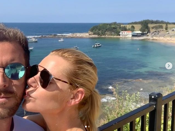 A photo of Sophie Monk kissing her boyfriend Joshua Gross on the cheek.