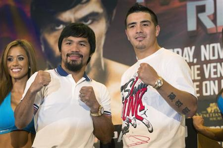 Boxers Manny Pacquiao (L) of the Philippines and Brandon Rios of the U.S. pose for photographs during a news conference in New York August 6, 2013. Pacquiao and Rios will fight in a welterweight match at the Venetian Macao in Macau on November 24. REUTERS/Shannon Stapleton