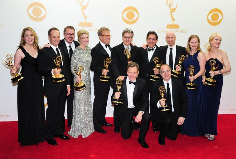 Actor Bryan Cranston (centre) and members of 'Breaking Bad' pose in the press room during the 65th Annual Primetime Emmy Awards in Los Angeles, California on September 22, 2013