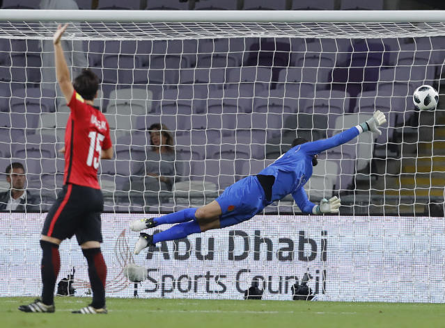 A shot from Japan's Urawa Reds Mauricio Antonio goes into the net for the opening goal during the Club World Cup soccer match for the fifth place between Wydad Athletic Club and Urawa Reds at the Hazza Bin Zayed stadium in Al Ain, United Arab Emirates, Tuesday, Dec. 12, 2017. (AP Photo/Hassan Ammar)