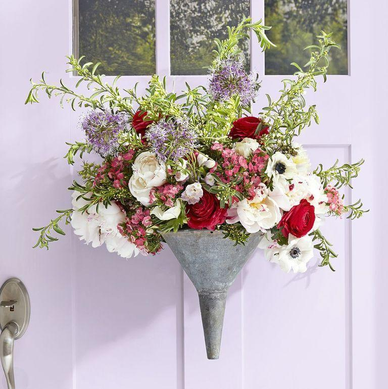 <p>Turn a basic galvanized funnel into a conversation piece with an organic arrangement of flowers and greens. </p>