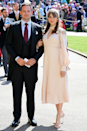 <p>Troian Bellisario and husband Patrick J. Adams were also in attendance for Meghan and Harry's wedding, and Troian's puff sleeve situation is TDF.</p>