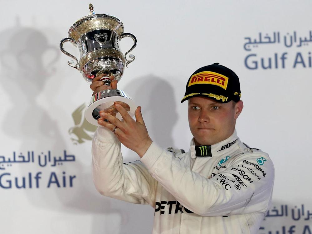 Bottas was visibly disappointed on the podium after finishing third (Getty)