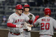 Los Angeles Angels Mike Trout (27) is congratulated by Jared Walsh (20) after his two-run home run during the ninth inning of a baseball game against the Kansas City Royals at Kauffman Stadium in Kansas City, Mo., Monday, April 12, 2021. (AP Photo/Orlin Wagner)