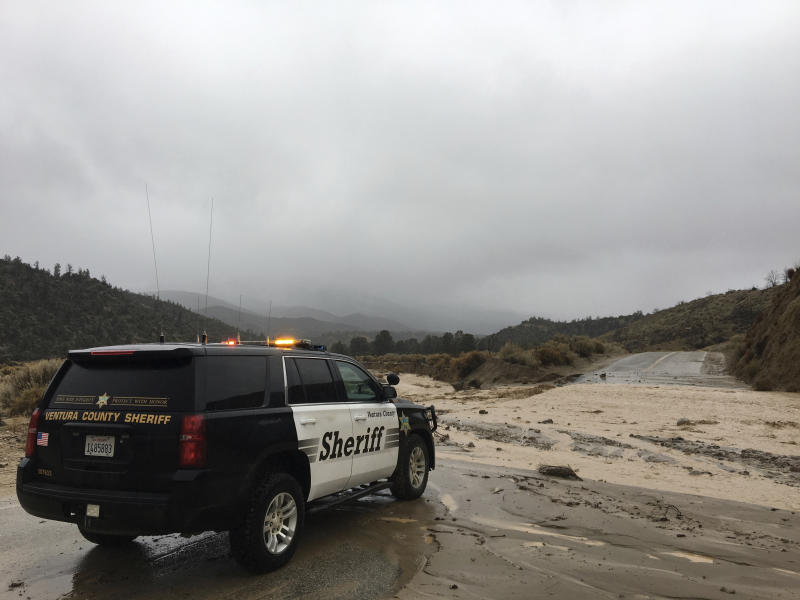 This Thursday, Jan. 17, 2019 photo provided by the Ventura County Sheriff's Dept. shows a flooded out crossing of Reyes Creek in Lockwood Valley in Ventura County, Calif. Californians were cleaning up and drying off Friday after a series of storms dumped heavy rain and snow throughout the state, caused at least six deaths and forced the rescue of more than a dozen people in rushing rivers.(Ventura County Sheriff's Dept. via AP)