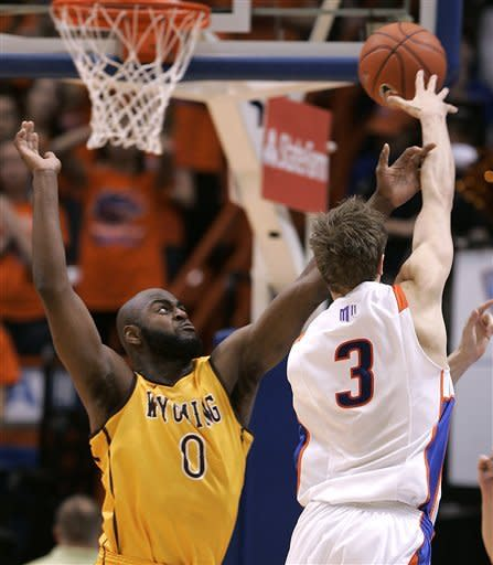 Wyoming's Leonard Washington (0) defends as Boise State's Anthony Drmic (3) passes during the first half of an NCAA college basketball game, Saturday, Feb. 9, 2013, in Boise, Idaho. (AP Photo/Matt Cilley)