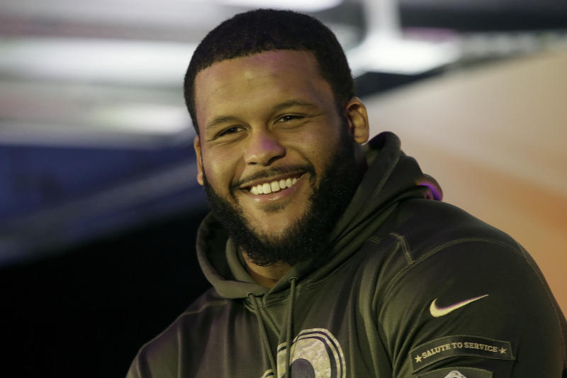 FILE - This Oct. 22, 2016, file photo shows Los Angeles Rams defensive tackle Aaron Donald on stage during an NFL Fan Rally in London. All-Pro defensive tackle Aaron Donald has agreed to a massive new contract with the Los Angeles Rams, ending his second consecutive preseason holdout as the highest-paid defensive player in NFL history. The Rams on Friday, Aug. 31, 2018, announced a new six-year deal through 2024 for Donald, the reigning NFL Defensive Player of the Year. (AP Photo/Tim Ireland, File)