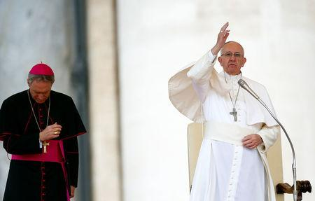 Pope Francis blesses at the end of special audience for Catholic Action members in St. Peter's Square at the Vatican