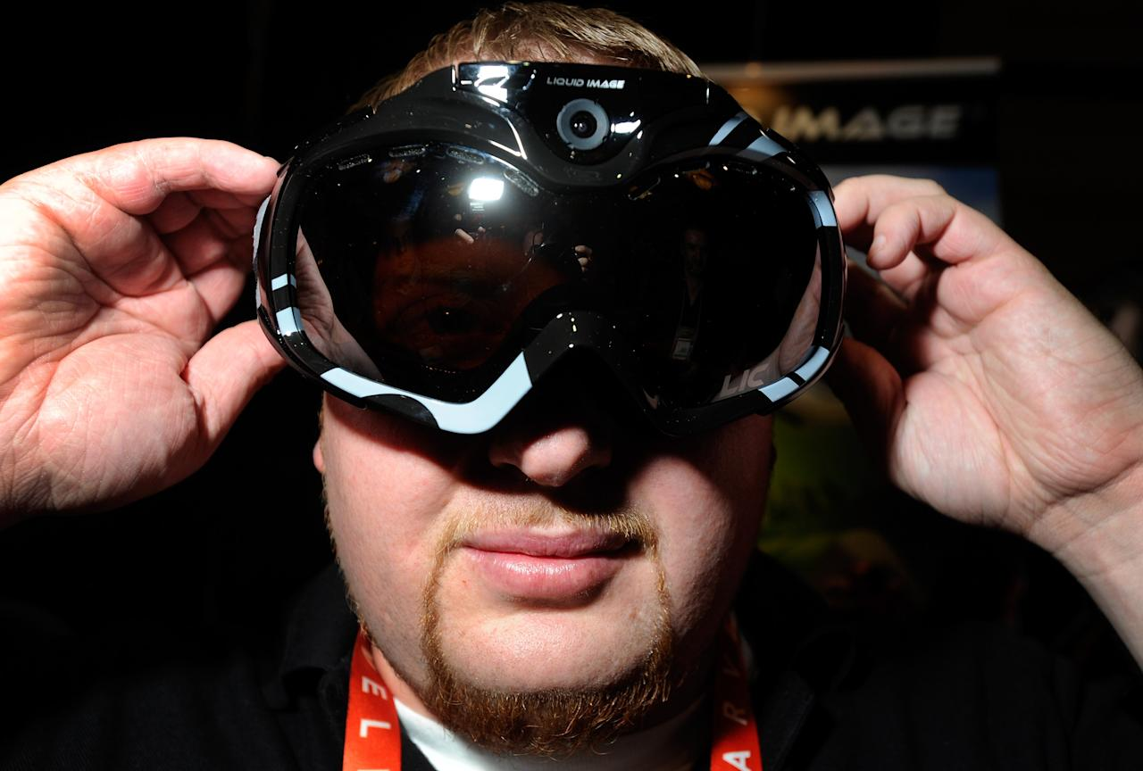 LAS VEGAS, NV - JANUARY 06:  John Noonan displays a pair of Liquid Image goggles with a built in camera at a press event at the Mandalay Bay Convention Center for the 2013 International CES on January 6, 2013 in Las Vegas, Nevada. The goggles which have built-in WiFi are currently available on the market and have a retail price of USD 399. CES, the world's largest annual consumer technology trade show, runs from January 8-11 and is expected to feature 3,100 exhibitors showing off their latest products and services to about 150,000 attendees.  (Photo by David Becker/Getty Images)