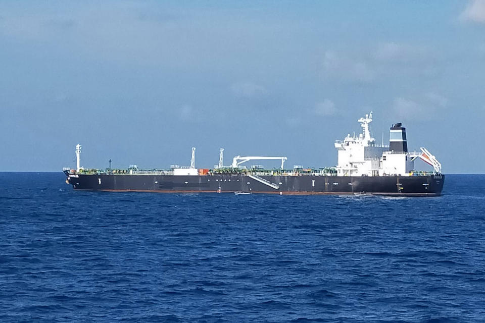 In this undated photo released by the Indonesian Navy on Wednesday, Aug. 25, 2021., the Bahamas-flagged tanker MT Strovolos is seen in the waters off Riau Islands, Indonesia. Indonesia's navy said Wednesday that it seized the oil tanker that is wanted by Cambodian authorities on suspicion of stealing 300,000 barrels of crude oil. (Indonesian Navy via AP)