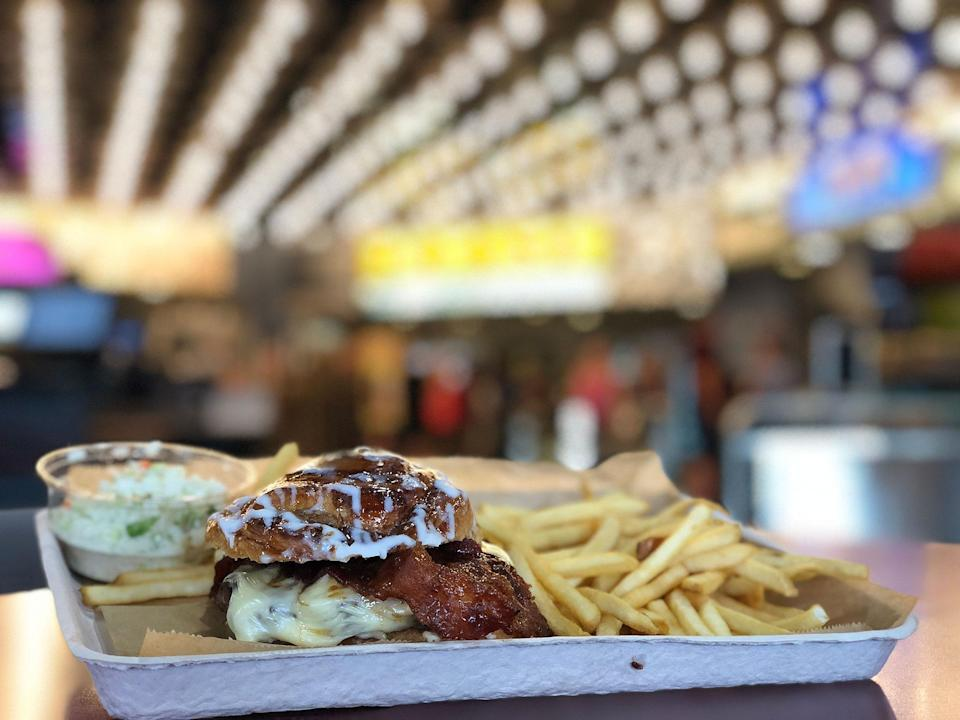 """<p><strong>Where to Get It: </strong>Disney's All-Star Movies Resort World Premiere food court ($14.99) <strong>Lou's Review: """"</strong>Walt Disney World has its share of secret menu items — things you won't find on the regular menu, but need to know and ask about. This decadent burger is one of the most interesting, creative, delicious, and fun. And it's as awesome as its name sounds! It's unique, delicious, savory, sweet and a little bit messy (in a good way). To get one, head over to the Roxy counter and ask about the secret menu items.""""</p>"""