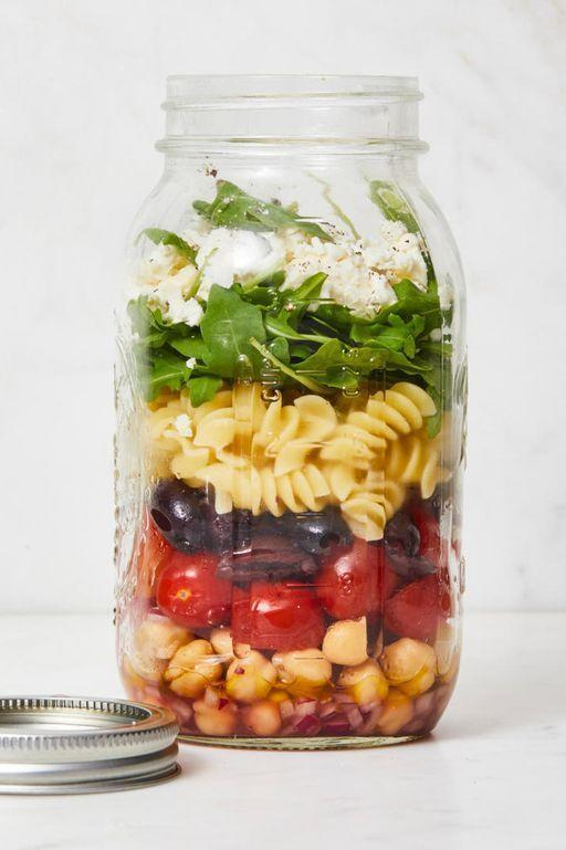 """<p>Unlike regular salads that get soggy by lunch, this jarred salad separates the greens from the dressing, so it's sure to stay fresh. Just shake up this Pinterest-worthy mason jar meal and you're good to go!</p><p><em><a href=""""https://www.goodhousekeeping.com/food-recipes/easy/a28639122/chickpea-pasta-salad-recipe/"""" rel=""""nofollow noopener"""" target=""""_blank"""" data-ylk=""""slk:Get the recipe for Chickpea Pasta Salad in a Jar »"""" class=""""link rapid-noclick-resp"""">Get the recipe for Chickpea Pasta Salad in a Jar »</a></em></p>"""