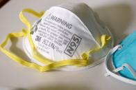 FILE PHOTO: Various N95 masks at a laboratory of 3M, that has been contracted by the U.S. government to produce extra masks in response to the country's novel coronavirus outbreak, in Maplewood, Minnesota
