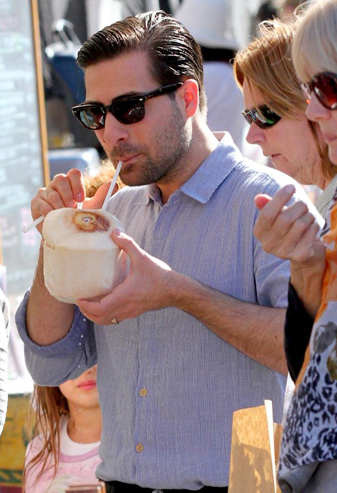 While hanging with his wife Brady and their 23-month-old son Marlowe at a farmers' market, Jason Schwartzman stopped to enjoy some fresh coconut water. (11/4/2012)