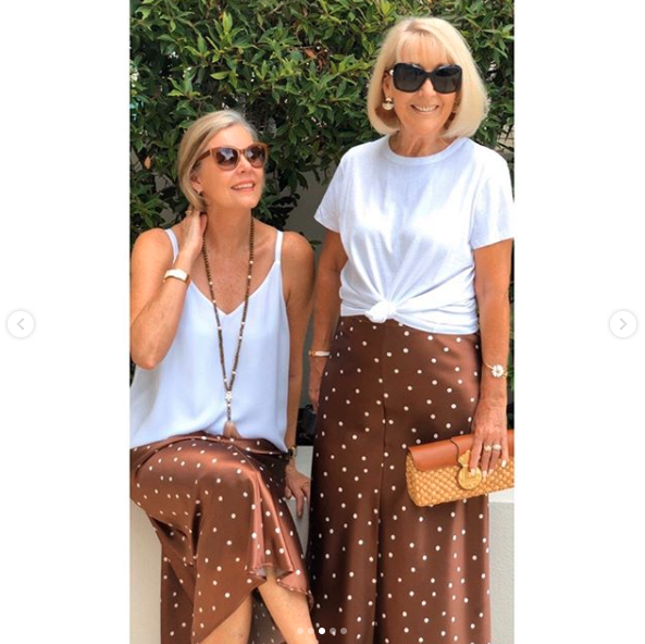 Two older women wear polka dot skirt for casual lunch style