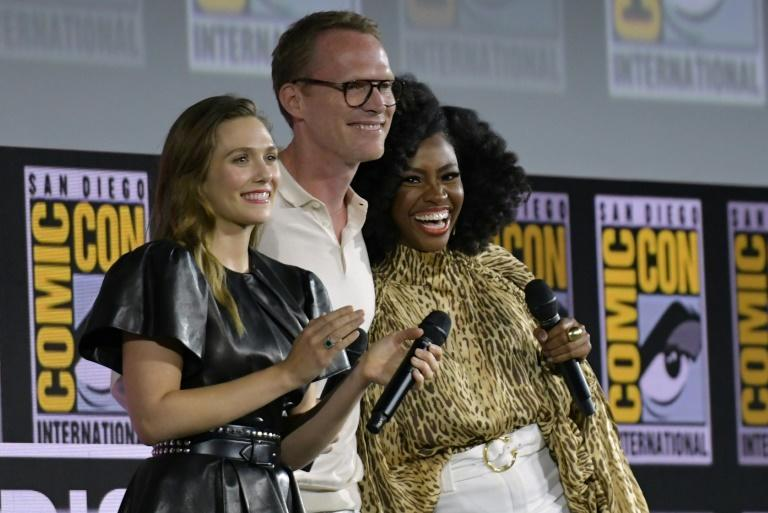"""(L-R) Actors Elizabeth Olsen, Paul Bettany and Teyonah Parris are the stars of the Marvel TV series """"WandaVision,"""" an Emmys contender"""