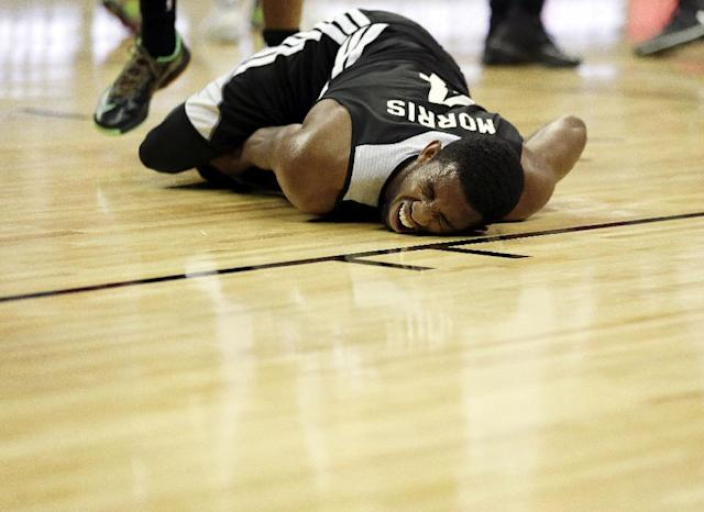 10ThingstoSeeSports - The San Antonio Spurs' Darius Morris writhes on the court after injuring a knee against the New Orleans Pelicans during the first half of an NBA summer league basketball game Monday, July 14, 2014, in Las Vegas. (AP Photo/John Locher, File)
