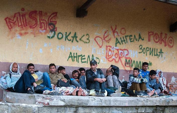 Migrants wait for a train at a station in Demir Kapija, south-eastern Macedonia, on June 18, 2015, on their way to the Serbian border (AFP Photo/Robert Atanasovski)