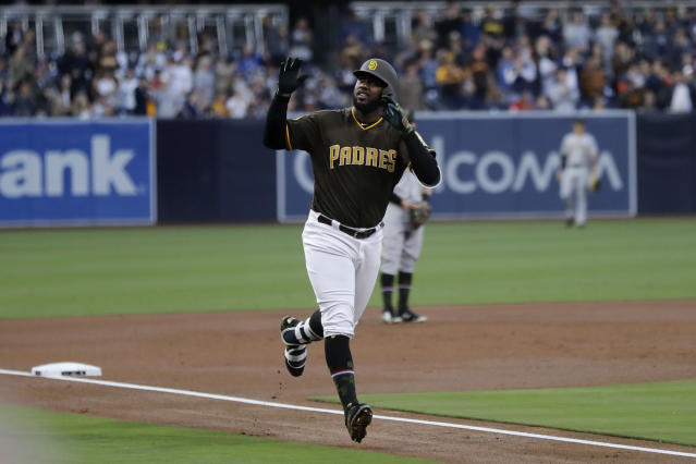 San Diego Padres' Franmil Reyes reacts after hitting a home run during the first inning of a baseball game against the Pittsburgh Pirates, Friday, May 17, 2019, in San Diego. (AP Photo/Gregory Bull)