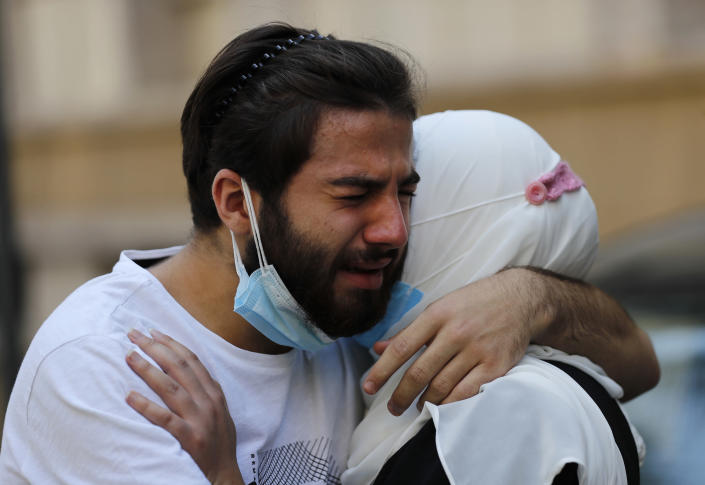 Relatives of Ibrahim Harb, 35, who was critically injured in the massive explosion at Beirut's port last year and who died on Monday nearly 14 months after the blast, mourn during his funeral procession in Beirut, Lebanon, Tuesday, Sept. 28, 2021. On Aug. 4, 2020, hundreds of tons of ammonium nitrate, a highly explosive material used in fertilizers, ignited after a massive fire at the port. The death brings to at least 215 the number of people who have been killed by the blast, according to official records. (AP Photo/Hussein Malla)