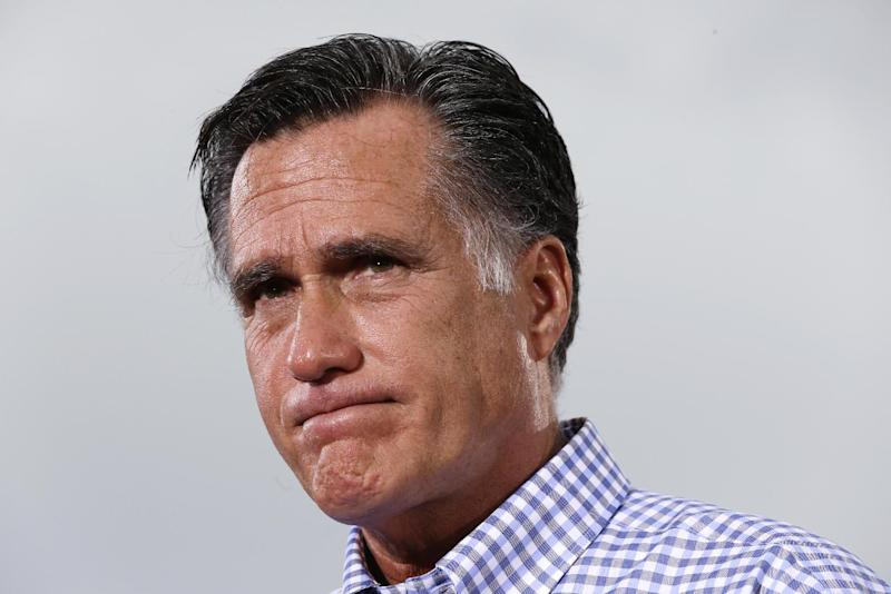 Republican presidential candidate and former Massachusetts Gov. Mitt Romney pauses as he tells a personal story while he campaigns at Tradition Town Square in Port St. Lucie, Fla., Sunday, Oct. 7, 2012. (AP Photo/Charles Dharapak)