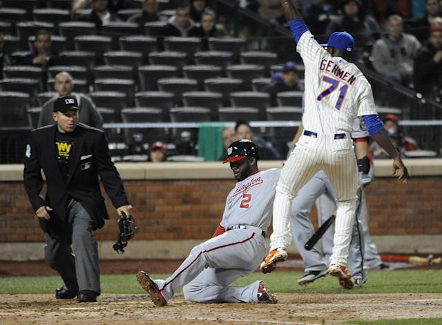 Washington Nationals' Denard Span (2) scores on a wild pitch by New York Mets relief pitcher Gonzalez Germen (71) in the seventh inning of a baseball game at Citi Field on Wednesday, April 2, 2014, in New York. (AP Photo/Kathy Kmonicek)