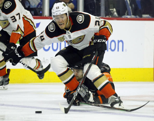Anaheim Ducks' Carter Rowney is tripped up by Philadelphia Flyers' Shayne Gostisbehere, who got a two minute minor penalty, during the third period of an NHL hockey game Saturday, Feb. 9, 2019, in Philadelphia. The Flyers won 6-2. (AP Photo/Tom Mihalek)