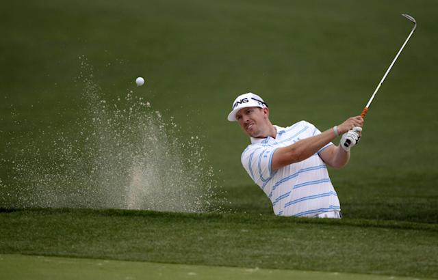 Hunter Mahan hits out of a bunker on the eight hole during the first round of the Houston Open golf tournament on Thursday, April 3, 2014, in Humble Texas. (AP Photo/Patric Schneider)