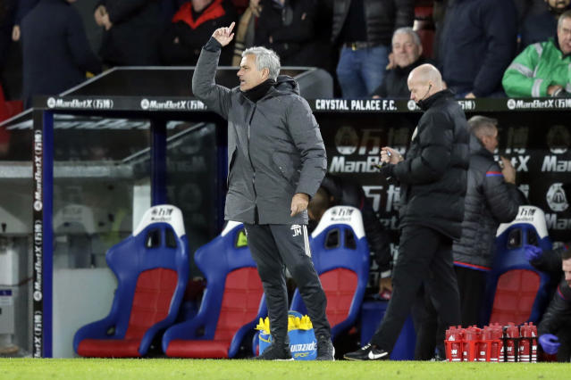 Manchester United manager Jose Mourinho, left, shouts instructions across the pitch after Crystal Palace's Patrick van Aanholt scored a goal during the English Premier League soccer match between Crystal Palace and Manchester United at Selhurst Park in London, Monday, March 5, 2018. (AP Photo/Tim Ireland)
