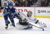 Los Angeles Kings goalie Jonathan Quick (32) covers up the puck and makes the save as Vancouver Canucks' Elias Pettersson (40), of Sweden, reaches for it during the second period of an NHL hockey game Wednesday, Oct. 9, 2019, in Vancouver, British Columbia. (Darryl Dyck/The Canadian Press via AP)