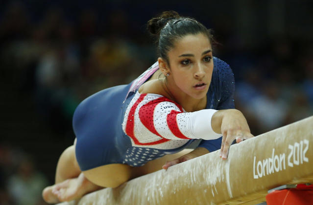 Alexandra Raisman of the U.S. competes in the women's gymnastics balance beam final in the North Greenwich Arena during the London 2012 Olympic Games August 7, 2012. REUTERS/Brian Snyder (BRITAIN - Tags: SPORT GYMNASTICS OLYMPICS)