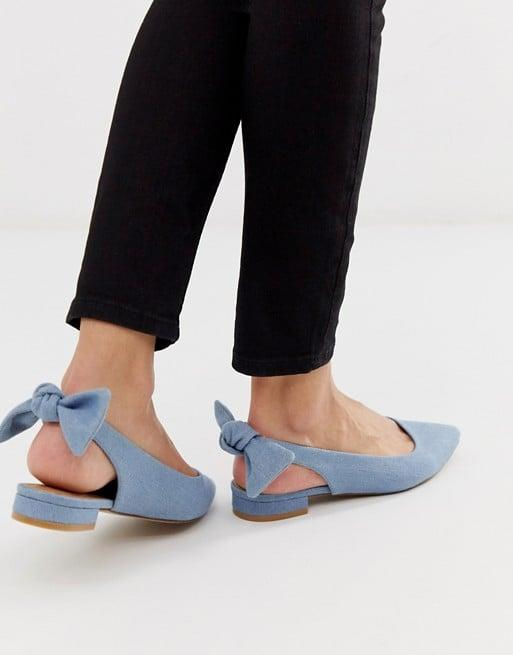 "<p>The back of these <a href=""https://www.popsugar.com/buy/ASOS-DESIGN-Lizzie-Bow-Slingback-Ballet-Flats-537843?p_name=ASOS%20DESIGN%20Lizzie%20Bow%20Slingback%20Ballet%20Flats&retailer=asos.com&pid=537843&price=26&evar1=fab%3Aus&evar9=45618089&evar98=https%3A%2F%2Fwww.popsugar.com%2Fphoto-gallery%2F45618089%2Fimage%2F47142156%2FASOS-DESIGN-Lizzie-Bow-Slingback-Ballet-Flats&list1=shopping%2Cshoes%2Ctrends%2Cbest%20of%202020&prop13=api&pdata=1"" rel=""nofollow"" data-shoppable-link=""1"" target=""_blank"" class=""ga-track"" data-ga-category=""Related"" data-ga-label=""https://www.asos.com/us/asos-design/asos-design-lizzie-bow-slingback-ballet-flats-in-denim/prd/12481806?clr=denim&amp;colourWayId=16411775&amp;SearchQuery=&amp;cid=6459"" data-ga-action=""In-Line Links"">ASOS DESIGN Lizzie Bow Slingback Ballet Flats </a> ($26, originally $35) is a fun surprise.</p>"